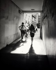 Life in the tunnel (Мaistora) Tags: tunnel light life city urban people pedestrians rushhour traffic walking cycling cyclist man woman lady hurry work office heels summer squaremile london moorgate finance banking business england britain uk shadows passage street walls texture backlight backlit contrejour silhouette projection rays beams glow cityworkers streetlife phone mobile galaxy s8 android app snapseed picsay bw blackandwhite mono monochrome film filmlike silver analog analogue print paper oldschool contrast grain vignette hcb