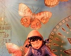 Story Board (clarkcg photography) Tags: ceramic girl butterfly orange light wheel rays darktolight dawn sunrise sunshinesunday purple white blue