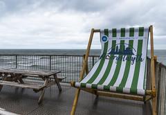 Aberystwyth (RedPlanetClaire) Tags: wales cardigan bay aberystwyth ceredigion holiday resort rain deck chair