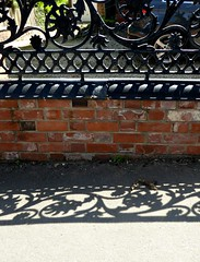 Shadows, (jenichesney57) Tags: street malvern wall bricks metal railing ornate black brick sun shadows panasoniclumix pavement red attern lacy