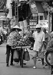 Humans with Hats in Hanoi (Mondmann) Tags: travel humans hats hanoi vietnam northernvietnam asia southeastasia street streetphotography candid monochrome bw blackandwhite mondmann fujifilmxt10 people vietnamese