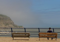 Hastings Haze (Grooover) Tags: seat view cliffs sea railings bench person hastings sussex grooover