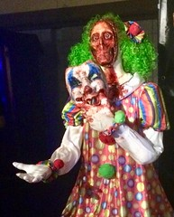 Killer clown with skull face and clown mask (JacksonSha) Tags: scary decoration costume blood green hair female clown removing face mask reignofterror haunted house long beach midsummer scream halloween horror convention 2018 killer creepy skull closeup