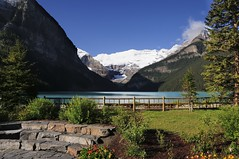 Lake Louise and Victoria Glacier, Banff National Park, Alberta. (edk7) Tags: nikond300 nikonnikkor18200mm13556gedifafsvrdx edk7 2008 canada alberta rockymountains rockies banffnationalpark lakelouise landscape mountain water sky rock bush flower snow lake glacier crag cliff cloud peak scree victoriaglacier mountvictoria garden park fence lawn grass step vista