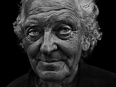 Closeup portrait of senior person (Ales Dusa) Tags: man closeup streetportrait elderly wrinkles strongcontrast alesdusa blackandwhite bw people human outdoor oldman charismaticman face detailedportrait handsome strikingportrait facial expressiveeyes canoneos5dmarkii ef50mmf18stm blackbackground oldwrinkledman person noir