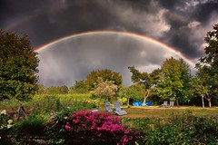 Rainbows and Sunshine (Missy Jussy) Tags: rain rainbow doublerainbow sunlight sunshine darkclouds clouds sky colourful trees plants garden grass pool fence labrugere saintyrieixlaperche france southcentralfrance landscape weather moodylandscape moody canon canon5dmarkll canon5d canoneos5dmarkii ef24mmf28