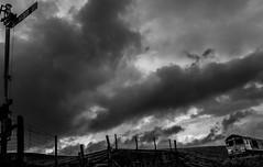 Blea Moor (Peter Leigh50) Tags: mono monochrome blackandwhite bw black white train shed semaphore signal clouds dark wet rain railway railroad rural rail bridge fence