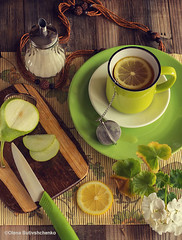 Tea with lemon in a green cup. Near the sugar bowl, a board with a green pear and a knife. Atmospheric photo. Fresh bright colors. Top view. (stok-1707) Tags: background beverage breakfast brown citrus closeup culture cup drink flowers food fresh freshness fruit glass green greencolor healthy herb herbal hot leaf lemon life light liquid nature nobody object overhead refreshment rustic slice still summer sweet table tea traditional white whitecolor wooden yellow