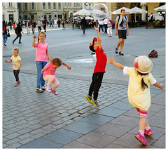 Kidz - Krakow, Poland (TravelsWithDan) Tags: children bubbles oldtown citysquare krakow poland playing jumping action people outdoors city urban candid canong3x