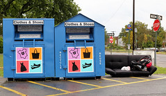 Recycling Center-on a rainy day (henulyphoto) Tags: box charity used goods poor road street donation clothes sofa sign stop blue