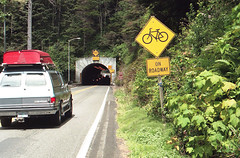 Bikes on Roadway (marmotfotos) Tags: bike road signs tunnel florence oregon biketrip biketouring