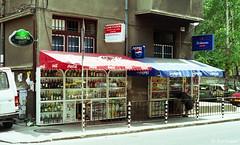 sofia (amazingstoker) Tags: sofia bulgaria shop hatch ground level alcohol booze canopy street t70 canon shopping groceries window display