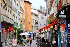 Downtown (Grenoble, France) (Haytham M.) Tags: umbrellas shops cafes stores buildings france grenoble pedestrians street
