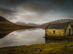 The Boathouse (Alan Hughes Mach) Tags: scotland highlands lochabhraoin ullapool fannaich fannich landschaft landscape scenery paysage paysaje loch lake water sky ciel cielo boathouse mountain mountains summit peak walking walk hike hiking contrast dof light sunshine cloud clouds reflection reflections snow weather fishing buoy winter february naturaleza natur natural canon wasser rural window building brown sunlight gold golden solitude peaceful red ball eye himmel outside outdoor tranquil vacation air mood