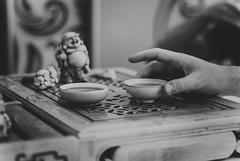 hand that stretches (YellowTipTruck) Tags: teaparty bunfight greentea blackandwhite bw tea crockery dishes pouredtea teagods teatable guestsofateaparty