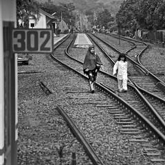 A school day in Yogyakarta (Robyn Hooz) Tags: treno train yogyakarta java station school scuola binario rail railway indonesia