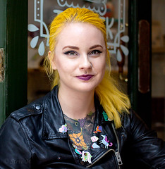 Katie - stranger 156/200 (englishreader) Tags: 100strangers strangers stranger strangerphotography street streetphotography streetportrait portrait portraitphotography portraiture headshot people peoplephotography female girl girls younglady youngwoman businesswoman artist illustrator enamelpins badges leather leatherjacket hair yellowhair door doorway entrance tattoos dinosaur dinosaurs flowers yellow green black glass zip daylight naturallight availablelight 50mmlens primelens canon thehumanfamily colour colours colourful color colors colorful nottingham