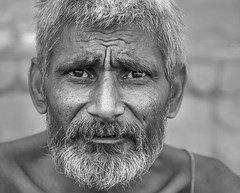 """""""Maybe you're actually crazy!"""" he thought. (andy_8357) Tags: street portraiture brahmin sanyasi sanyasin renunciate kind intelligent man black white blanc y noir blanco negro sony a6000 6000 alpha friendly engaging engaged animated sigma 60mm f28 dn art ilce6000 ilcenex fun rapport surprised crazy e mount emount people person low light lowlight"""