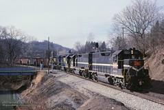 MGA 2002-2000 P&LE 2030-2039, Waynesburg, PA. 1-24-1990 (jackdk) Tags: train railroad railway locomotive emd emdgp38 emdgp382 gp38 gp382 coal coaltrain coaldrag mga monongahela monongahelarailway ple pittsburghandlakeerie standardcab fallenflag crossing