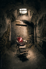 The Unrepentant | Eastern State Penitentiary (CM Goodenbury (FloodSpectre)) Tags: abandoned urbandecay urbex urbanexploration ue chair red redchair barberchair cell prison penitentiary skylight algae ruin crumbling dust jail lightshaft cmgoodenbury floodspectre canoneos6d sigma1224mmf4dghsmart 2018 philadelphia pennsylvania usa