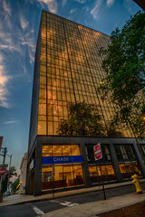 Chasing the morning light (tquist24) Tags: chase chasebank connecticut hdr newhaven nikon nikond5300 architecture building city clouds firehydrant geotagged reflection reflections sidewalk sky skyscraper street sunlight tree trees windows unitedstates