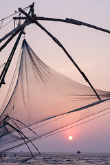 Chinese Fishing nets (Kristaaaaa) Tags: chinesefishingnets fishing india travel sunset arabian sea