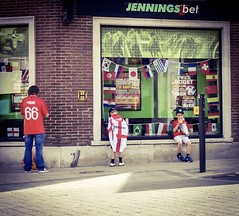 Waiting for Dad (denise.ferley) Tags: oneaday fun citylife citystreet 66moore peopleinthestreet peoplewatching bettingshop streetlife streetphotography 61 englandvpanama worldcup2018 kids footballfans uk thisisnorwich thisisengland england