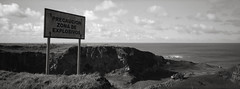 Explosives Zone, Easter Island (austin granger) Tags: explosives easterisland rapanui topography caution sign coast construction land warning film xpan evidence