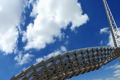 Oklahoma City - Bridge in the Sky (Drriss & Marrionn) Tags: oklahomacity oklahoma skydancepedestrianbridge skydance bridge okc sky architecture art landscape landscapes modernism white blue construction steel bright clouds cloud bluesky skies cloudy cloudysky riverside perspective dnysmphotography dnysmsmugmugcom