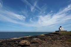 bamburgh lighthouse (Johnson Cameraface) Tags: 2018 june summer olympus omde1 em1 micro43 mzuiko 1240mm f28 johnsoncameraface bamburgh lighthouse northumberland rocks sea clouds sky coast