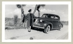 """1939 Buick Coupe (Vintage Cars & People) Tags: vintage us usa america vintageusa classic black white """"blackwhite"""" sw photo foto photography automobile car cars motor vehicle antique auto girl woman lady style fashion coat hat pumps heels 1939 buick 1939buick whitewalltyres sidewalltires whitewalls joshua joshuatree joshuatrees yuccabrevifolia desert 1940s forties"""
