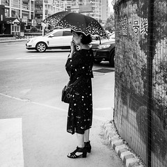 Finger in the nose (Go-tea 郭天) Tags: old lady woman qingdao huangdao shandong finger noze dirty behave behaviour bad umbrella sunshade dress cars alone lonely portrait street urban city outside outdoor people candid bw bnw black white blackwhite blackandwhite monochrome naturallight natural light asia asian china chinese canon eos 100d 24mm prime