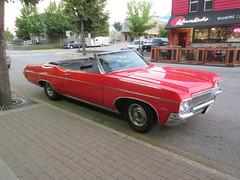 Cruising (jamica1) Tags: car auto automobile red convertible revelstoke downtown bc british columbia canada 350