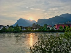Sunrise over Kaiser mountains and the river Inn near Kufstein in Tyrol, Austria (UweBKK (α 77 on )) Tags: österreich austria tyrol tirol europe europa iphone sun sunrise light bright river inn water flow reflection kaiser mountains alps kufstein sky clouds morning early