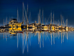 Golden Order (Natalia Medd) Tags: ocean sea reflection port marina water yachts blue contrast symmetry sky boats summer summertime order bold bright colour sunset