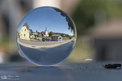 Mon village bouleversant (Philippe Bélaz) Tags: 105mm courtepin d800e bokeh boule effets eglise focalefixe insolites paysages sphère urbain villages été