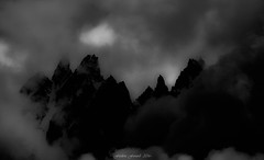Mountain Dark Side (Frédéric Fossard) Tags: sky noiretblanc blackandwhite dark dramatique dramaticsky moodysky nuages clouds lumière light alpenglow mist storm orage tourmente fog alpes hautesavoie cimes crêtes arêtes silhouette chamonix massifdumontblanc aiguillesdechamonix grain contraste atmosphère mood picdemontagne darkside mountainridge mountainrange aiguillesrocheuses clairobscur