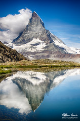 The Matterhorn viewed across Riffelsee (NDSD) Tags: alps alpine range mountain reflection cloud landscape sky blue white light dark green summer winter snow climbing drama dramatic view switzerland europe european colours horizon lake tarn epic mountaineering