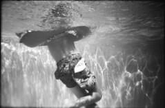 float (Arpadkoos) Tags: float water pool child people underwater blackandwhite splashii polaroid