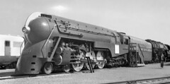 New York Central Dreyfus Designed Streamlined J-3 Hudson steam locomotive # 5451, is seen while on display at the Worlds Fair in Flushing Meadows, New York City, 1939 - 1940 (alcomike43) Tags: 19391940worldsfair flushingmeadows newyorkcity newyorkstate trains railroads displays locomotives steam engines steamengines j3class hudwon henrydreyfus dreyfusstreamlinedhudsonsteamlocomotive 5451 newyorkcentral norfolkwestern aclass articulatedsteamlocomotive talgotrain photo photograph bw blackandwhite old historic vintage classic scullindiscdrivers