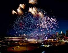 July Fireworks at the  Stampede (John Andersen (JPAndersen images)) Tags: alberta calgary cityskyline fireworks grandstand powerline sunset