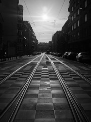 Dark Ways (Ren-s) Tags: olympus em10 lumix g street rue streetphotography black white noir blanc noiretblanc noirblanc blackwhite blackandwhite bnw bw nb contrast lumière light shadows contrejour silhouette backlight bruxelles brussel belgique belgium europe summer été new tracks voies tram train ciel sun soleil sky nuages clouds damier cars voitures route road path pathway cable immeuble building city ville town