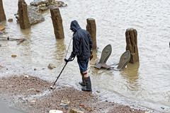 The Detectorist (Geoff Henson) Tags: metal detector detectorist beachcomber treasure search river water rain beach posts anchor rust tide