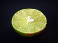 Limes with slices (www.icon0.com) Tags: lime lemon slice green whole white leaf citrus fruit closeup isolated ripe foliage nobody tropical studio full half section cut plant background branch nature food raw