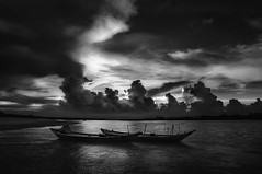 Castle of clouds .. (tchakladerphotography) Tags: cloudscape scenic boat natural nature dark moody cloud environment view water weather sky atmosphere birds dramatic cloudy travel landscape evening dusk sunset sailboat photography blackwhite bw river damodor india pallaroad