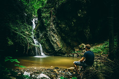 Man sitting and watching small waterfall (focusonmore.com) Tags: europe forest green holidays mariborskopohorje nature outdoor outside pohorje slovenia travel traveltheworld tree vacation water waterfall rock people river man