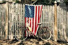 Flag and Bike (Read2me) Tags: pree cye flag bike bicycle fence old vintage slats thechallengefactorywinner tcfunanimouswinneraugust ge friendlychallenges
