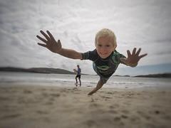 Mid flight (Busker12) Tags: photooftheday smile fun family summer coast busker12 boy sand beach jump hero5 gopro