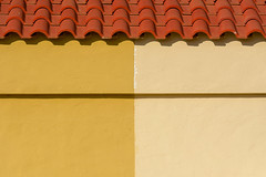 Roof and wall (Jan van der Wolf) Tags: map18182v rooftiles roof dak dakpannen symmetric symmetry symmetrie wall muur yellow white wit geel line lijn geometric geometry geometrisch geometrie fuerteventura