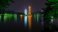 The Pagodas of the Moon and Sun (Dan_Fr) Tags: guilin china guangxi shan lake sun moon pagoda reflection architecture travel longexposure illumination light sony a7r city tree building tower